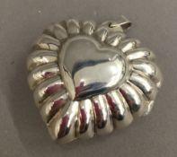 A silver heart pendant