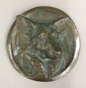 A bronze roundel,