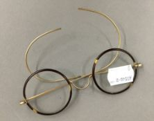 A pair of gold mounted spectacles