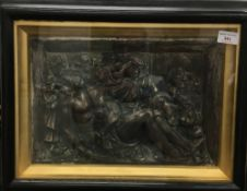 A 19th century white metal religious relief plaque, in an ebonised framed,