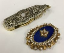 A Florenze costume jewellery brooch together with a pair of lorgnettes