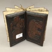 An Eastern concertina book with carved wooden covers