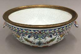 A 19th century Rouen faience bowl with gilt metal rim