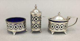 A three piece silver cruet set