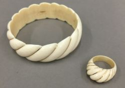 A 14 K gold mounted carved bangle,