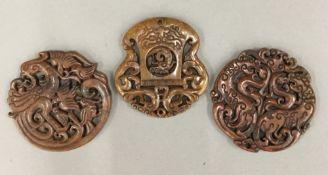 Three Chinese carved hardstone roundels