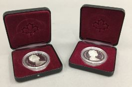 Two silver Canadian dollars,