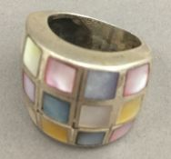 A silver and mother-of-pearl ring