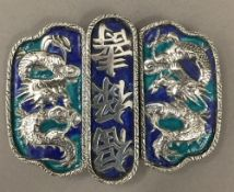 A vintage Chinese silver and enamel belt buckle with calligraphy and dragons