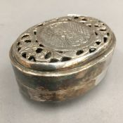 An Indian white metal soap dish and cover