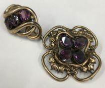 An amethyst set Victorian yellow metal brooch,