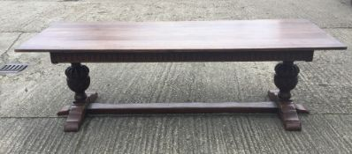 A large carved oak refectory table