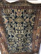 A Shirvan wool rug, with geometric cruciforms on a midnight blue ground,