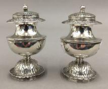 A pair of colonial silver spice pots, circa 1820.