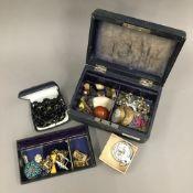 A box of vintage jewellery,