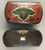 Two 19th century papier mache polychrome decorated table snuff boxes