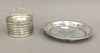 A set of six sterling silver and cut glass coasters in a sterling rack and a sterling silver and