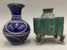 An Eastern incense burner and a vase,