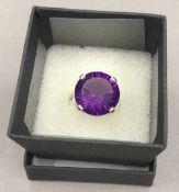 A silver amethyst ring