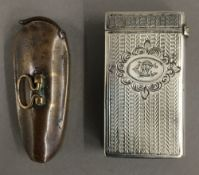 A 19th century silver vesta of book form and a 19th century brass vesta in the form of a violin