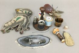A small quantity of items, including a Victorian bead work pin cushion, a hard stone fruit, etc.