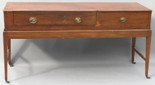 A 19th century mahogany square piano converted to a desk The rectangular top section with two