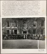 A black and white photographic military print of Daphne du Maurier standing outside Menabilly with
