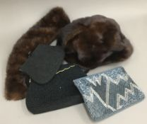 Three evening clutch bags belonging to Daphne du Maurier, one black beaded bag with flower detail,