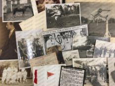 A collection of black and white military photographic prints and other ephemera relating to