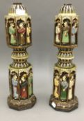 A pair of Eastern carved and painted lamp bases