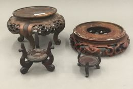 Four carved Chinese stands