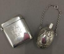 An oversized silver vesta by Samson Mordan & Co.