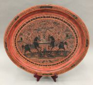 A decorated red lacquered tray