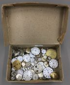 A box of pocket watches and watches parts,