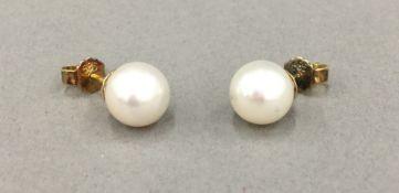A pair of pearl earrings