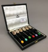 A set of six cased silver coloured coffee bean finial coffee spoons