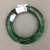 A carved jade bangle