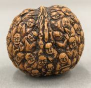 A Chinese walnut carved with multiple figures