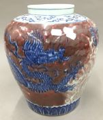 A large Chinese porcelain vase decorated with a dragon