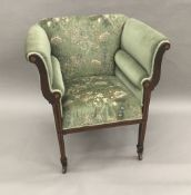A Victorian inlaid mahogany upholstered armchair