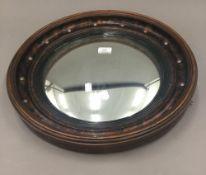 A convex wall mirror