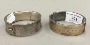 A silver cuff bangle and another (69.