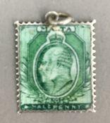 An enamelled white metal Maltese stamp,