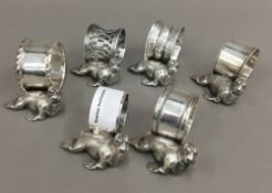 Six silver plated napkin rings,