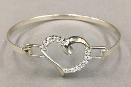 A silver heart bangle