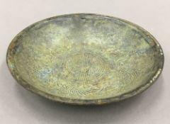 A Chinese round bronze dish