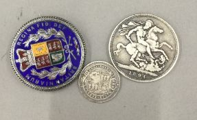 A small quantity of silver coins, one enamelled and formed as a brooch (64.