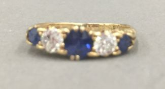 A gold, possibly 18 ct, diamond and sapphire ring (2.