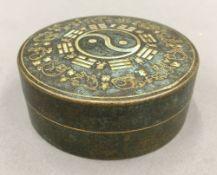 A Chinese round bronze box