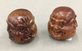Two carved wooden four faced Buddhas